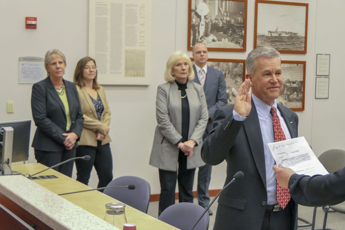 Gary Medvigy (right) is sworn in Tuesday by Clark County Council Clerk Rebecca Messinger. Photo by Chris Brown