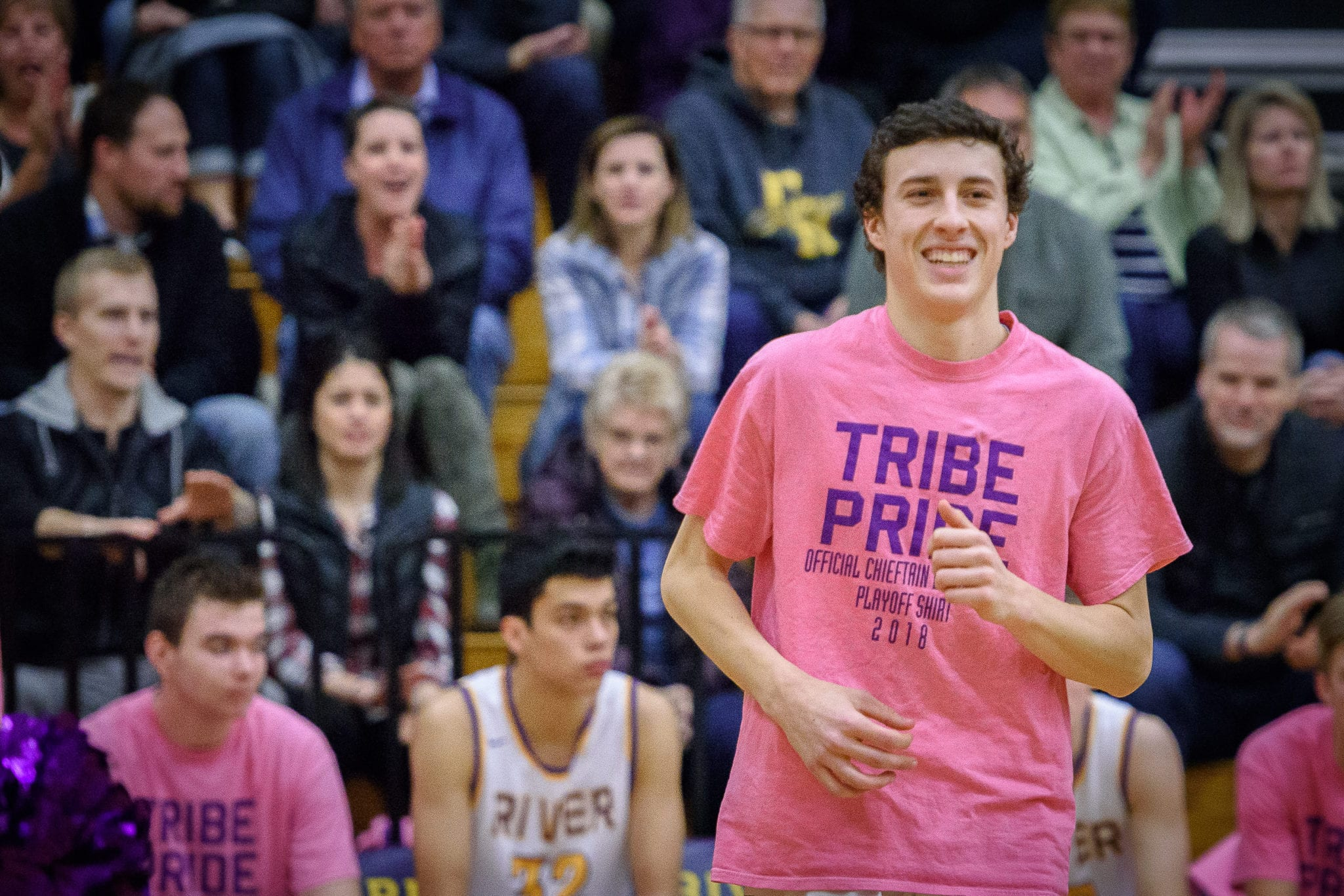 Alex Miller of Columbia River, shown here last season, says this is one of his favorite photos. He is wearing pink, in honor of his mother, while being introduced before a playoff game. His mother is in the stands, cheering for him. Jaime passed away last spring. Photo courtesy Ken Waz