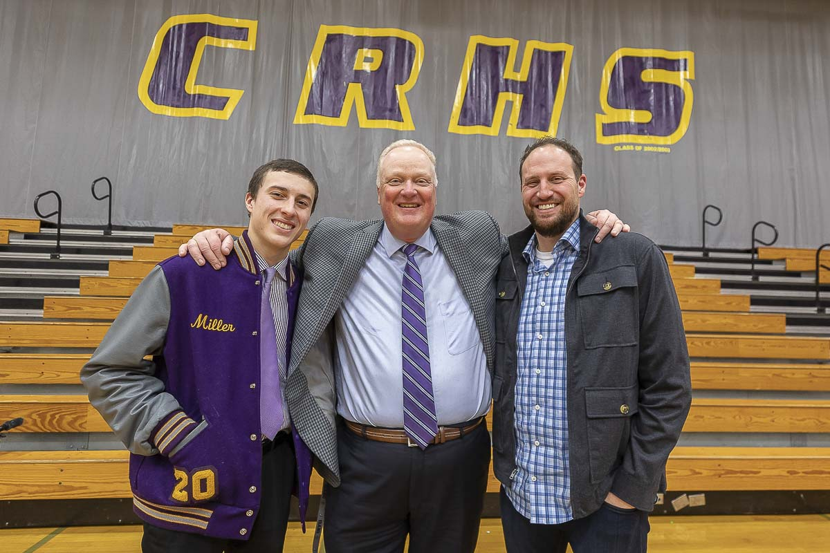 Columbia River basketball coach David Long, middle, was Andy Miller's head coach in the 1992-93 season. This year, he is coaching Andy's son, Alex. Columbia River and basketball are part of what connects the Miller family. Photo by Mike Schultz