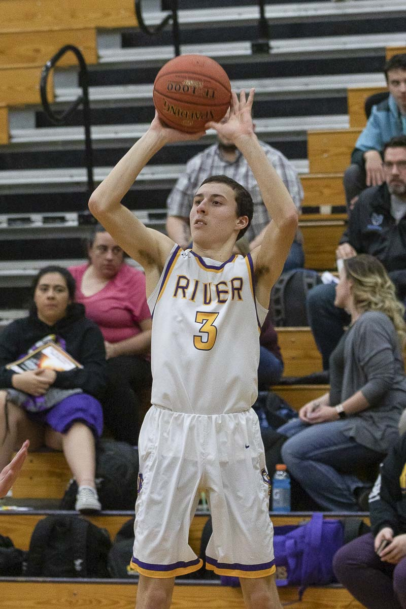 Alex Miller, a junior, is a key contributor to Columbia River's league championship basketball team. He plays at the same school, for the same coach, as his dad played for in the 1992-93 season. Photo by Mike Schultz