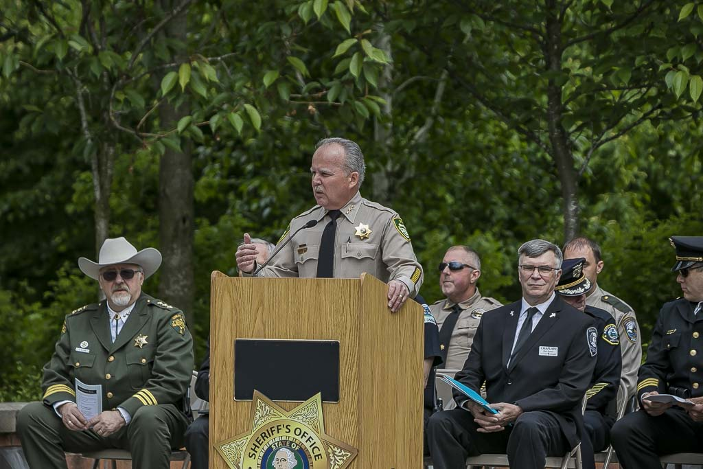 Clark County Sheriff Chuck E. Atkins speaks at the Clark County Law Enforcement Memorial Ceremony during the summer of 2018. Photo by Mike Schultz