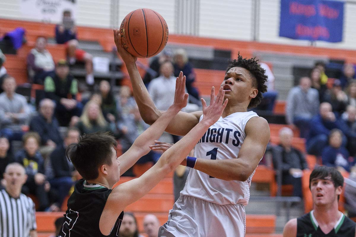 Khal Cason uses his strength to control basketball games on offense and defense. He has a motor that never quits for King's Way Christian. Photo by Ken Waz