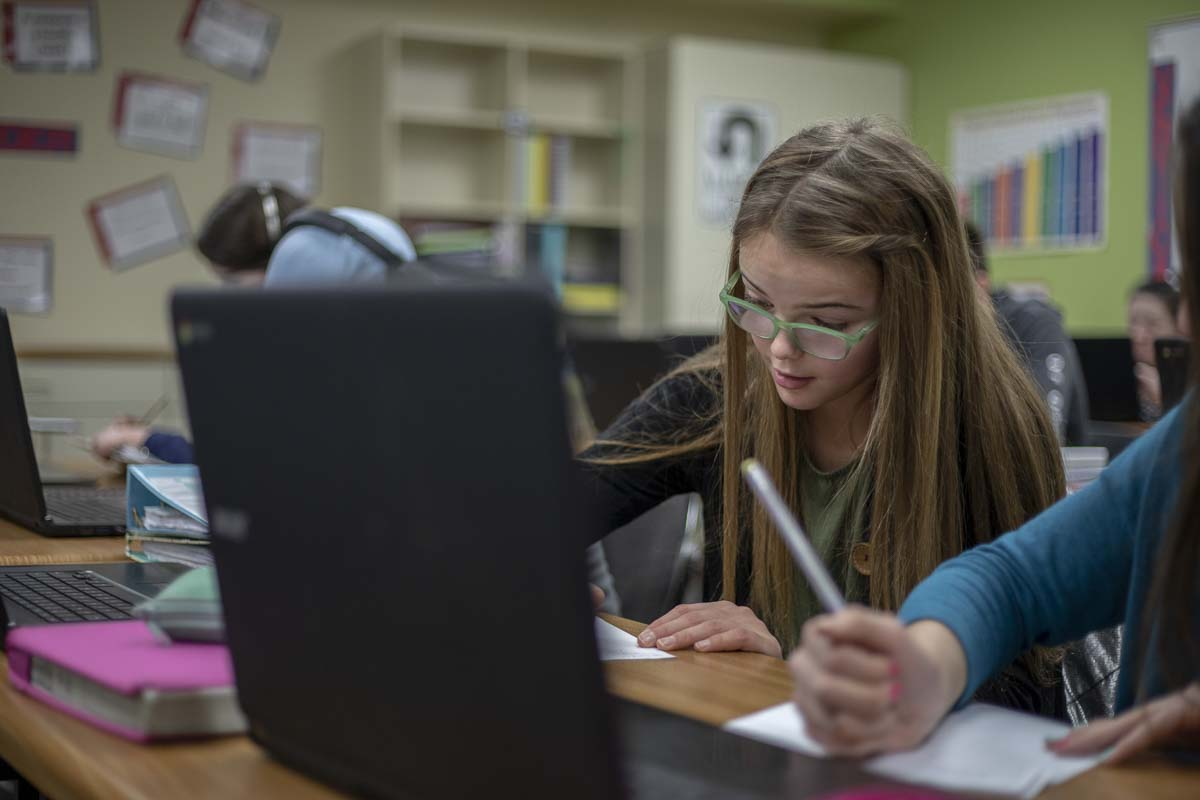 King's Way Middle School student Teagan Smith works on trigonometry on her laptop in class in 2019.
