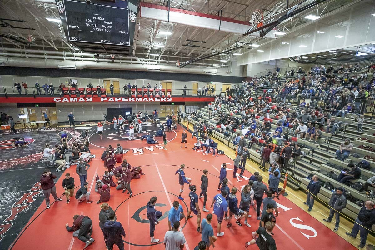 The Class 4A regional wrestling event at Camas did go on Friday, eliminating half the field. The eight who survived qualified for state when the WIAA cancelled all Saturday wrestling due to weather across Washington. Photo by Mike Schultz