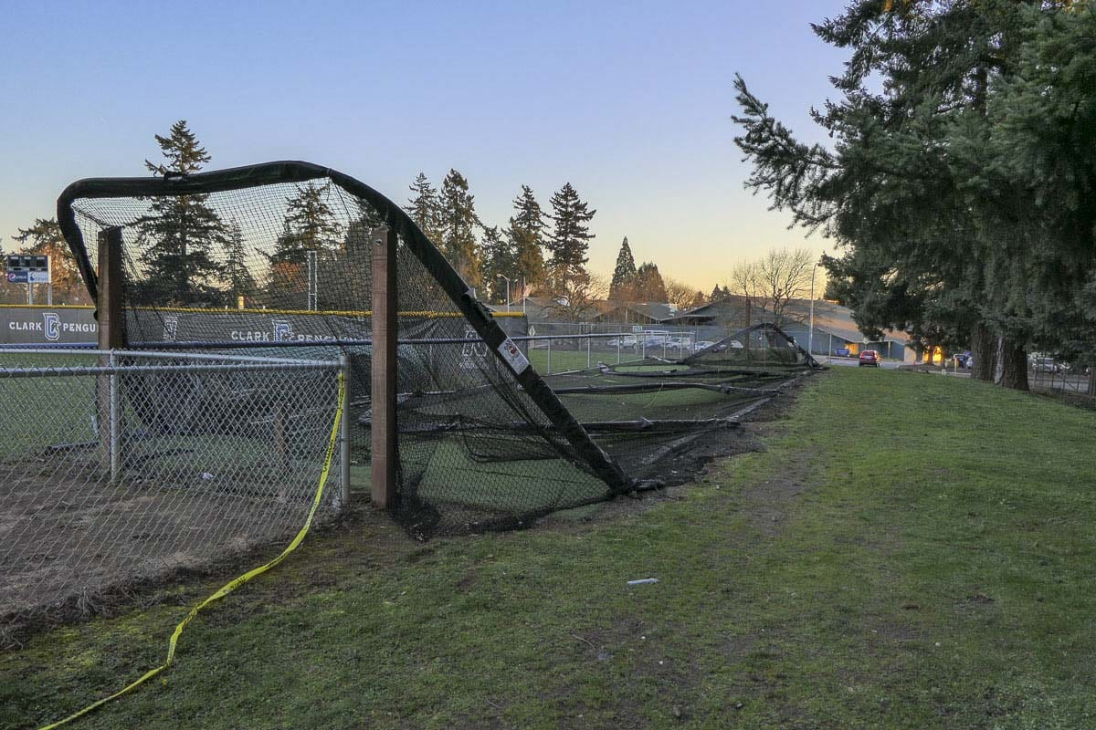 A batting cage lies in ruin at the Clark College softball field. Photo by Chris Brown