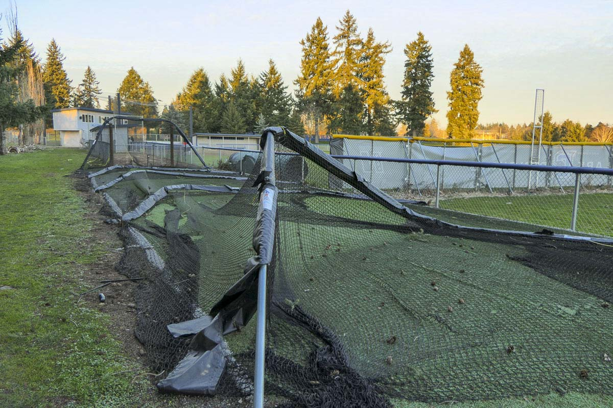 Transients are blamed for destroying a batting cage at the Clark College softball field. Photo by Chris Brown