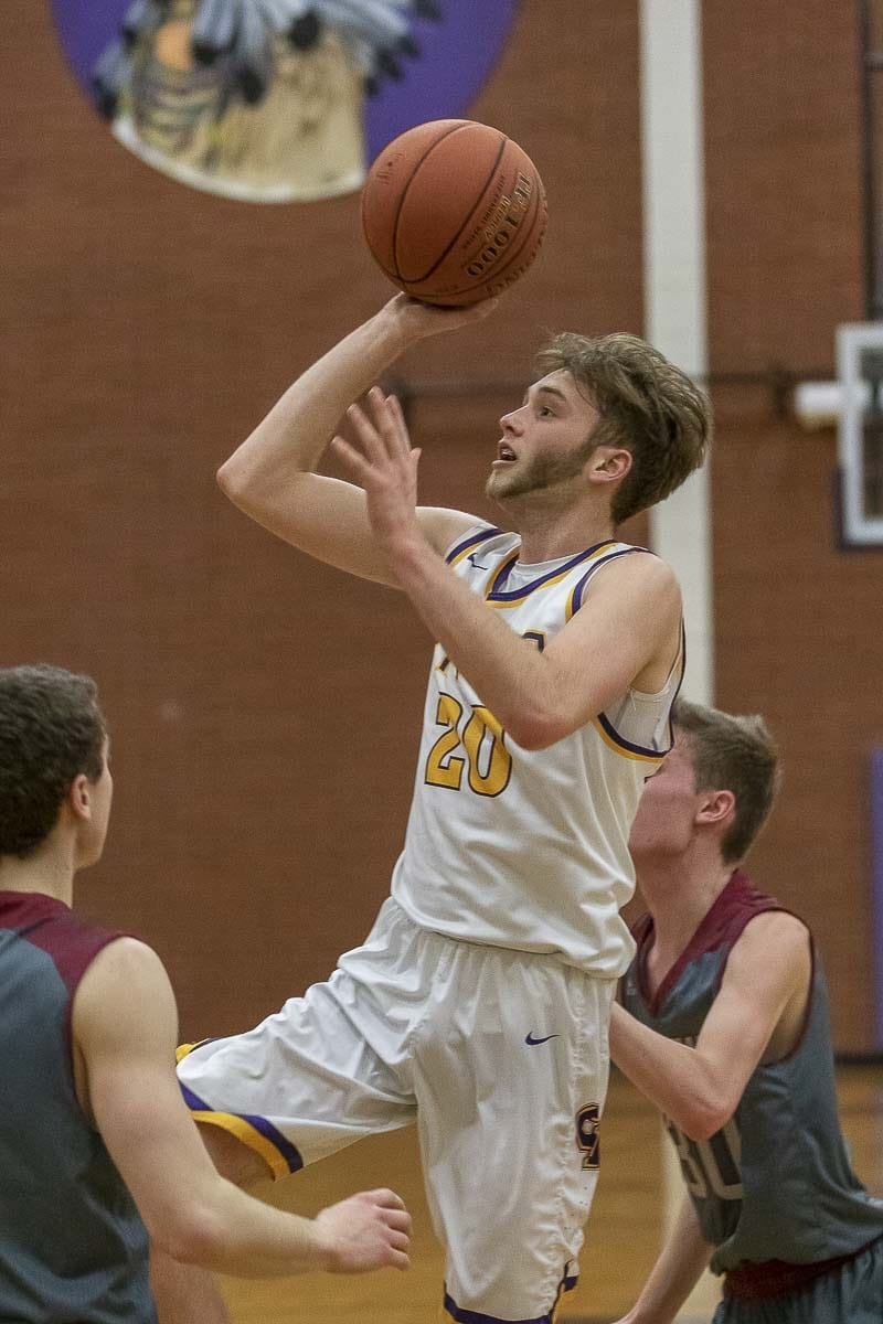 Caden Dezort of Columbia River scored 14 points in River's playoff victory Tuesday night. Photo by Mike Schultz