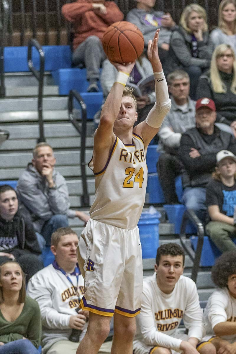 Jack Armstrong, shown here earlier this season, led a balanced attack for Columbia River, scoring 12 points in a 49-37 win over Anacortes in the Class 2A state boys basketball tournament. River will take on Lynden at 10:30 a.m. Thursday in the quarterfinals at the Yakima Valley SunDome.