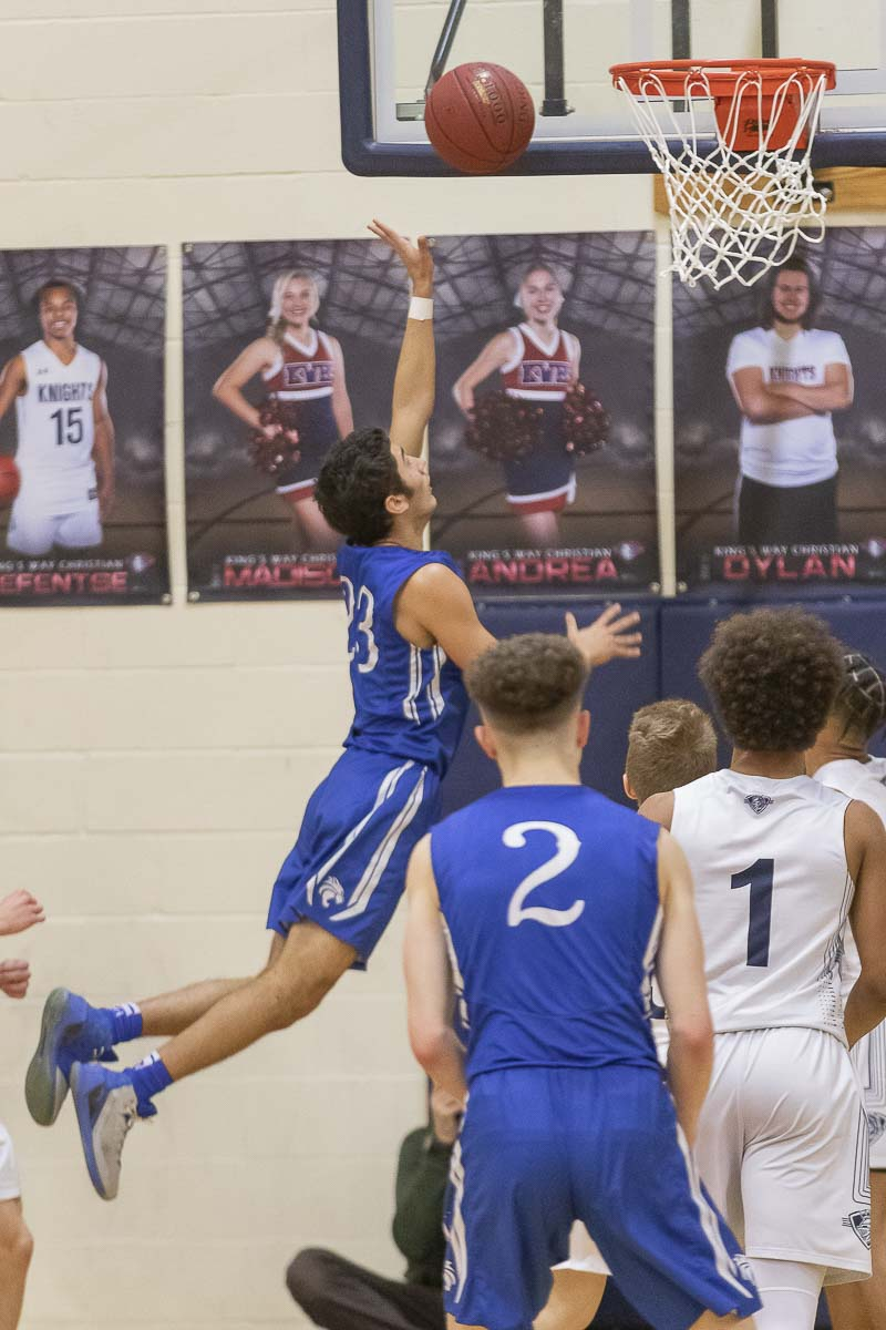 Hunter Ecklund skies high toward the basketball during La Center's win over King's Way Christian. Photo by Mike Schultz