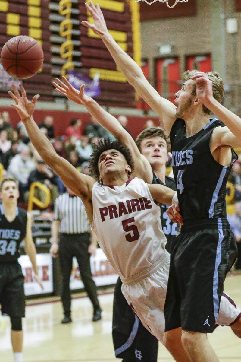 Prairie's Zeke Dixson muscles toward the basket during Prairie's 56-41 win over Gig Harbor in a Class 3A bi-district boys basketball game. Photo by Mike Schultz