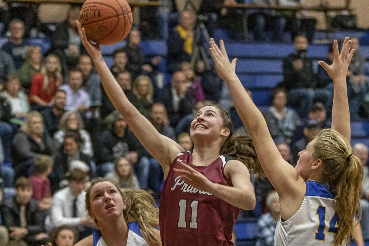 Kendyl Carson of Prairie, shown here earlier this season, was all smiles again Thursday after helping Prairie advance to the Class 3A state semifinals. She scored 12 points in a win over Edmonds-Woodway. Photo by Mike Schultz