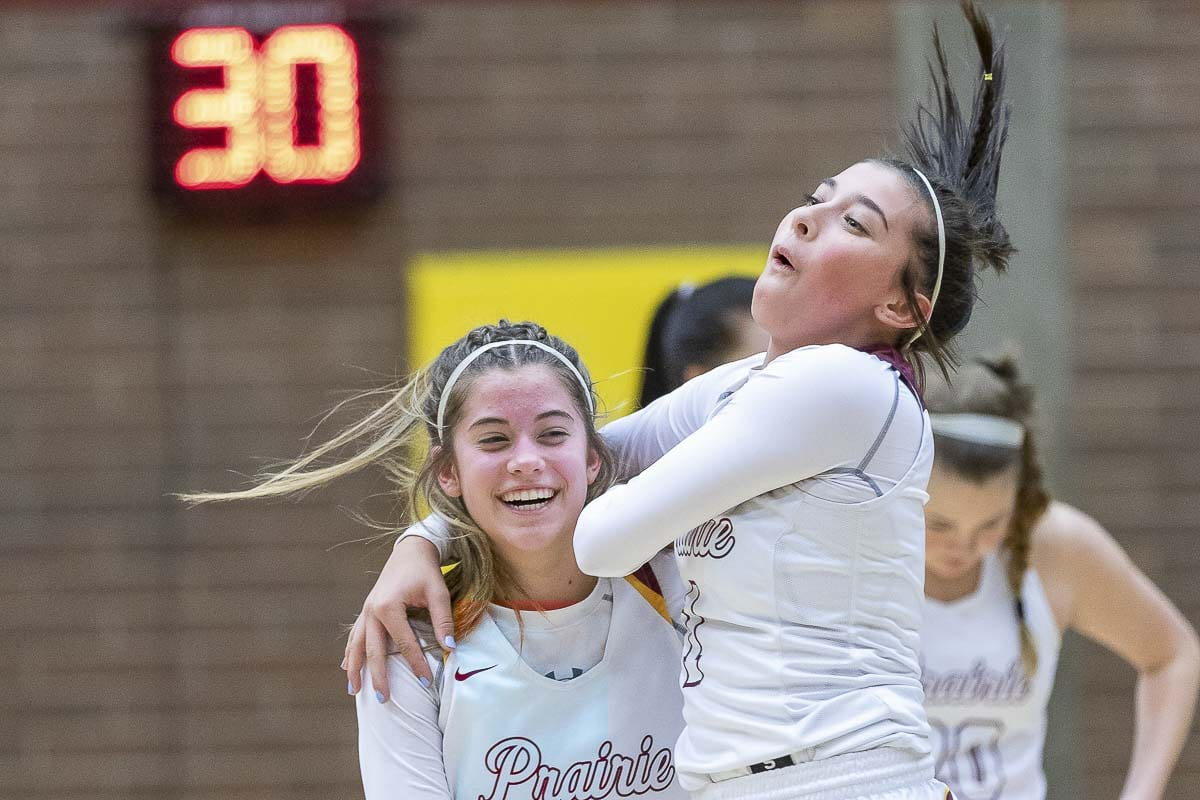Prairie's Cassidy Gardner and Dayna Vera celebrate another victory, another trip to state. Prairie secured its 22nd consecutive trip to state with a 61-35 win over Lincoln on Wednesday. Photo by Mike Schultz