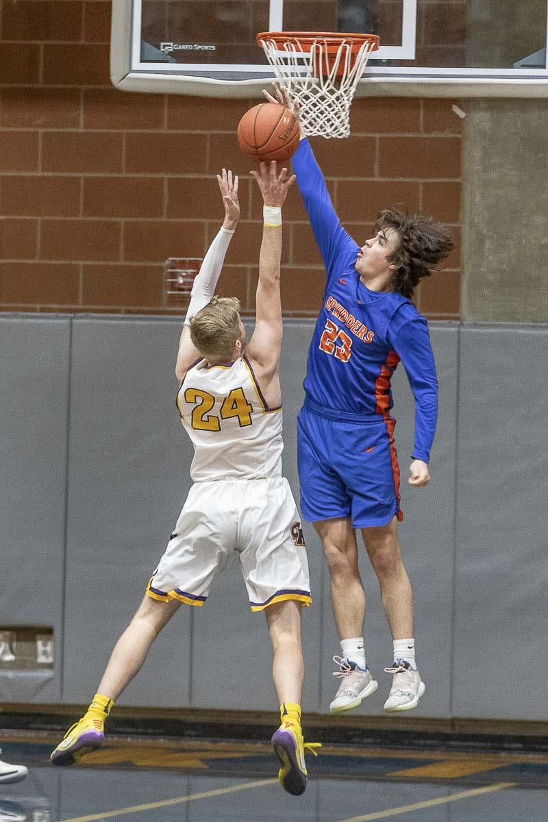 Ridgefield's Matt Gama skies high while playing defense in Thursday's Class 2A district semifinal. Ridgefield lost and fell into the consolation bracket. Photo by Mike Schultz