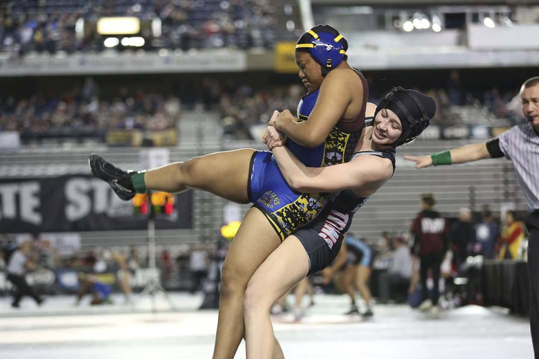 Union senior Annabelle Helm takes down an opponent during Mat Classic, on her way to winning a state championship. Her victory helped Union win the girls team title, as well. Photo courtesy of Betty Snediker
