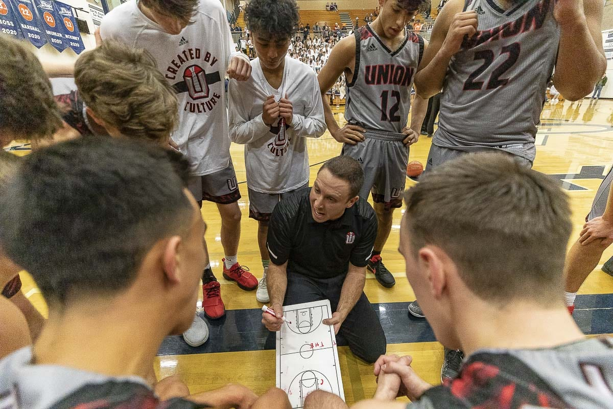Union coach Blake Conley, shown here in January, expects to be back in the huddle Friday night for the state regional playoff game against Battle Ground. He missed the last two games as he and his wife welcomed their first child. Photo by Mike Schultz