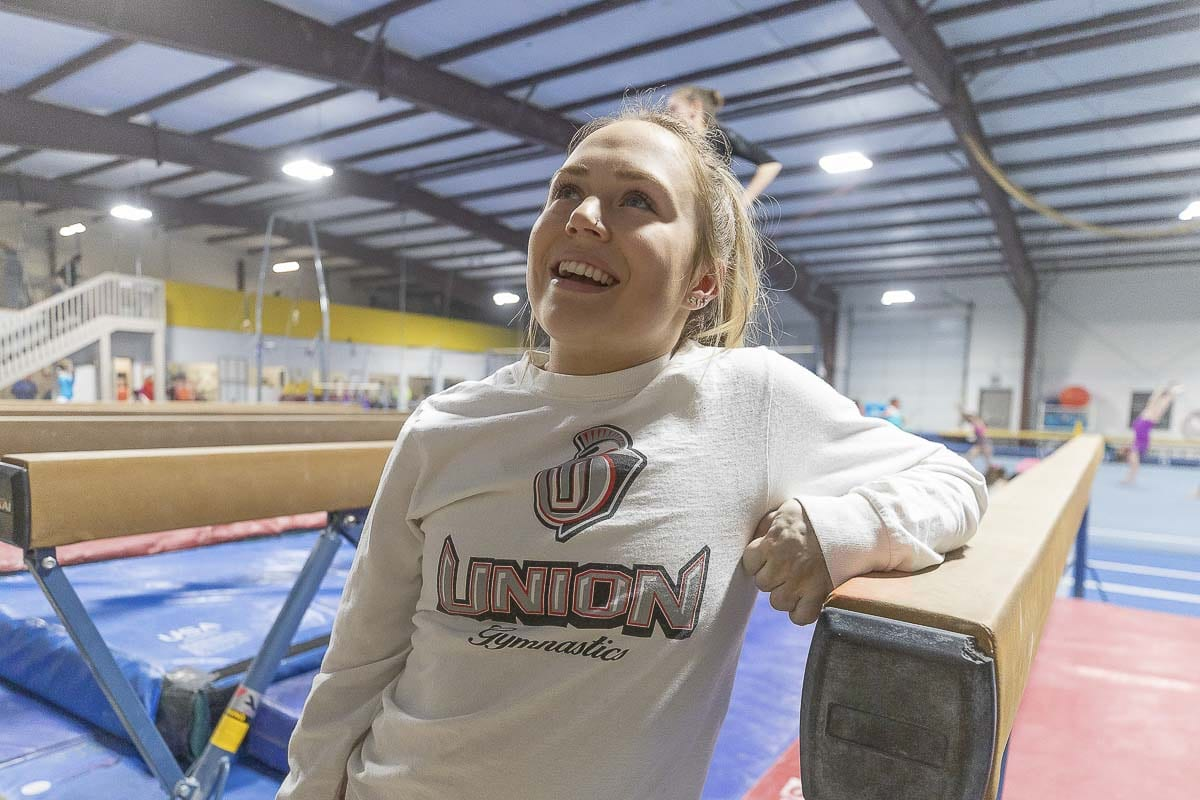 Mac Ridgway of Union said she never wanted her condition — she suffers from blood clots, her blood vessels are weak, and her left arm is shorter than her right arm — as an excuse to not do anything. So she become a top gymnast. Photo by Mike Schultz