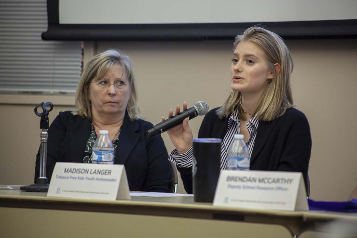 Madison Langer, (right), a student ambassador and senior in high school, speaks about her experiences when using vape products. She now teaches curriculum to persuade students not to vape. Photo by Jacob Granneman