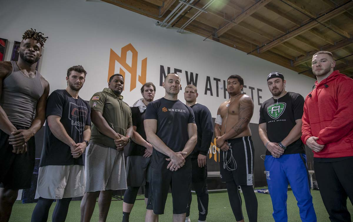 Ryan Paul, (center), founded New Athlete in 2001, and has since grown the business into a successful training program that has served thousands of area athletes from high school to the pros. Photo by Jacob Granneman