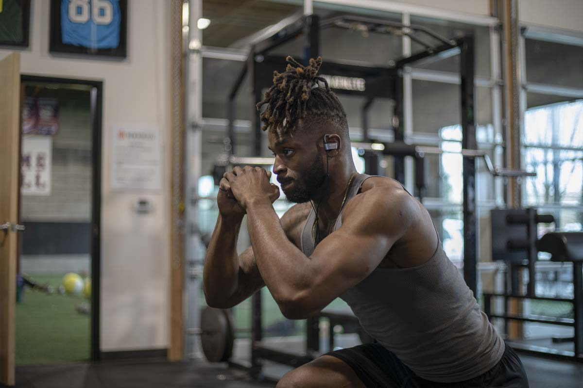 Joshua Smith practices squats as part of training and rehabilitation for pro day tryouts for the NFL. Smith just came off of knee surgery, and sees New Athlete as the way to regain strength and agility. Photo by Jacob Granneman