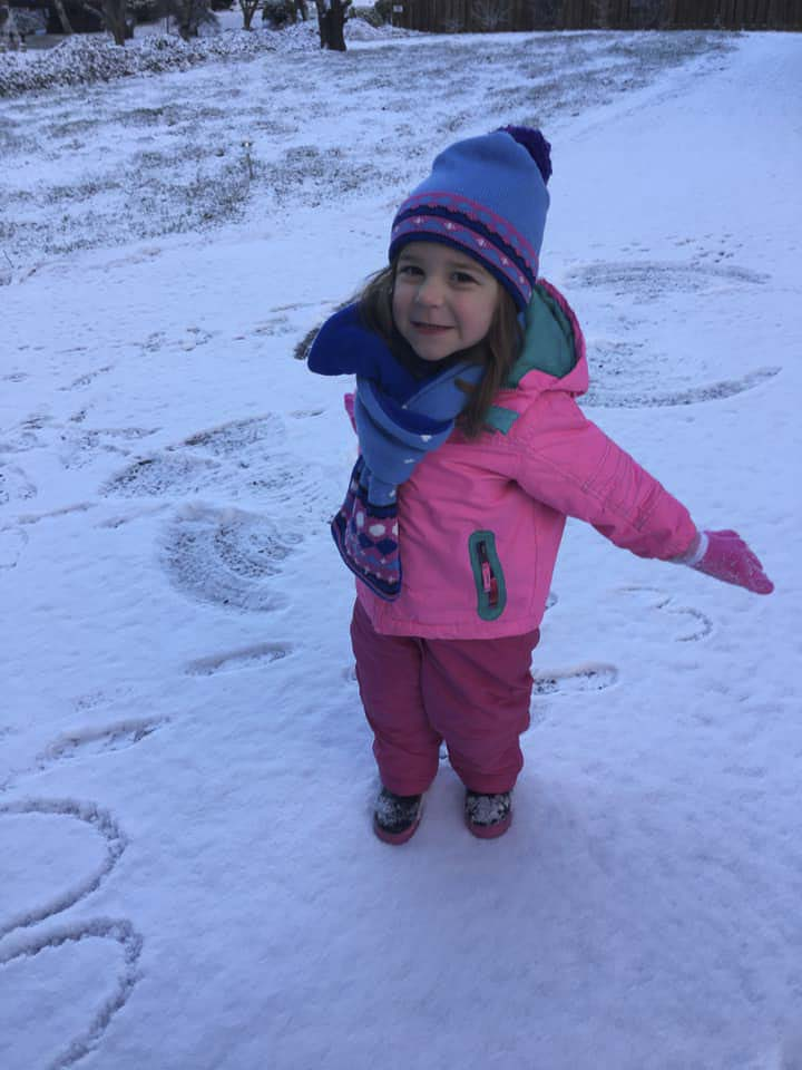 Three-year old Madelyn Wagner enjoyed the brief snowfall on Tuesday. Photo courtesy of Melissa Wagner