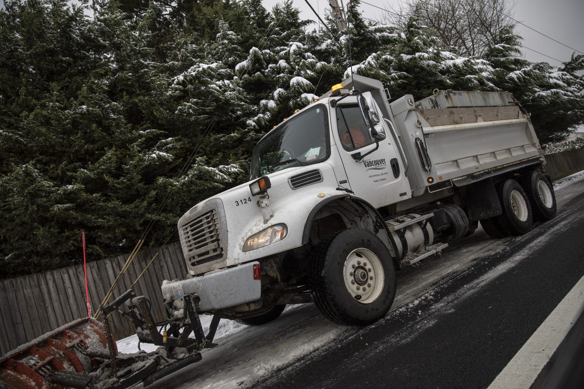 A snow plow runs down neighborhood roads in the Burton-Evergreen area of East Vancouver. Photo by Jacob Granneman