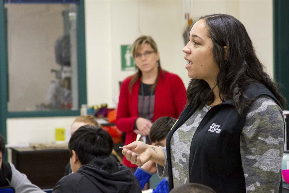 Shantelle Davidson, a community outreach specialist for Fibre Federal Credit Union, guided Woodland's eighth graders through a variety of activities teaching the importance of education. Photo courtesy of Woodland School District