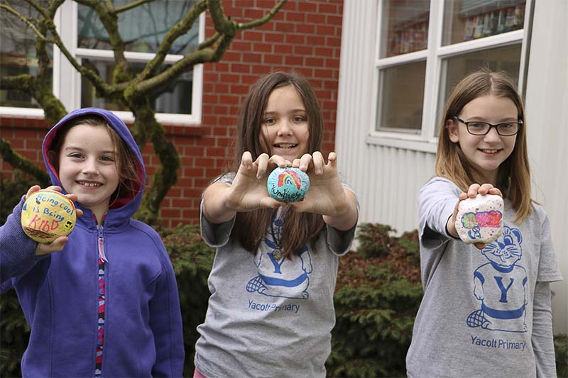 Three fourth grade leaders show off their kindness rocks. Photo courtesy of Battle Ground School District