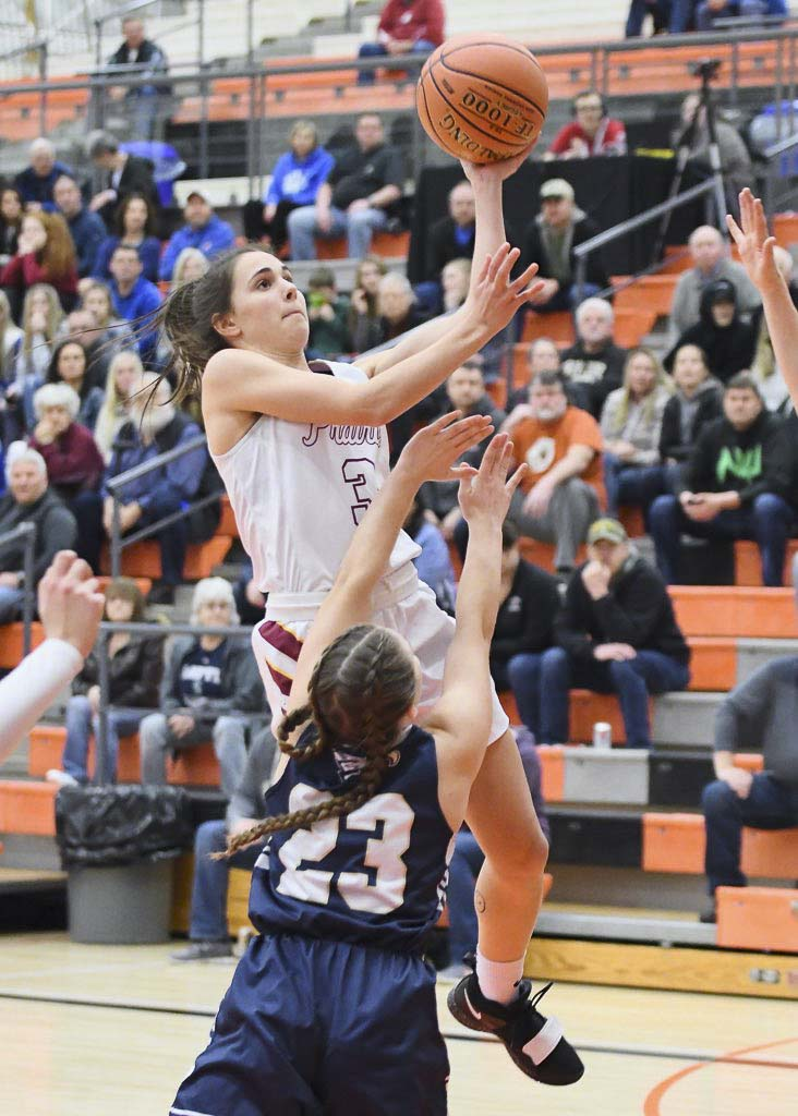 Meri Dunford came off the bench and scored six points and grabbed six rebounds for Prairie. She and Haley Reed had huge moments on defense for the Falcons, as well. Photo by Kris Cavin
