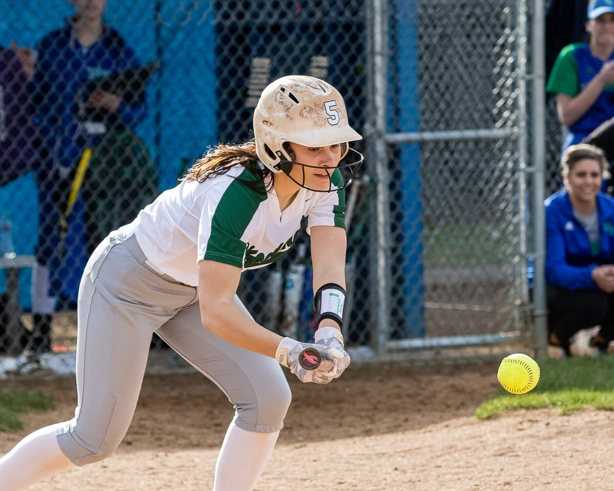 The Woodland Beavers can blast softballs out of the park but also play small ball when required. Here, Peyton Foster attempts to get the bunt down to advance a teammate. Photo by Mike Schultz