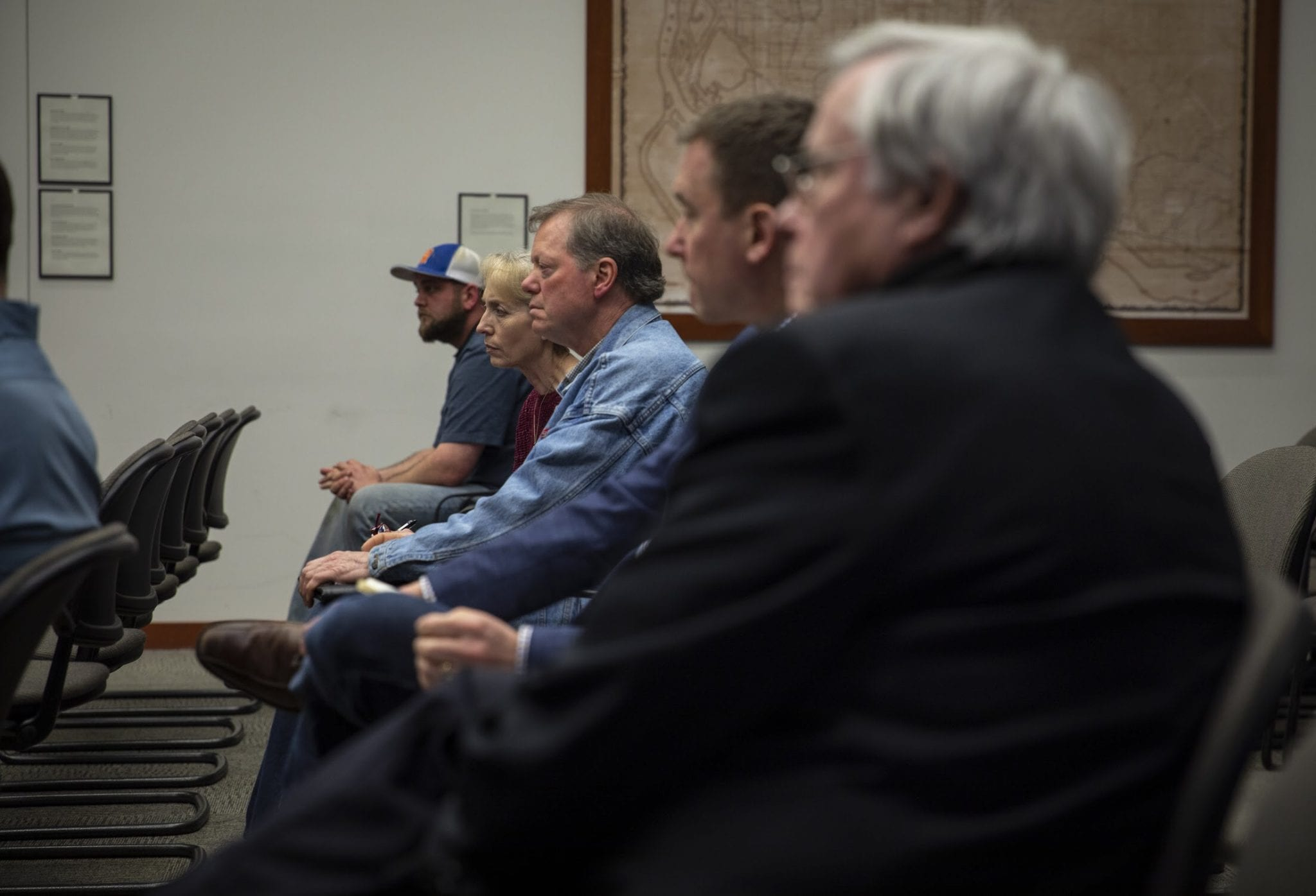 Gary Ogier (center) and other community members during the first meeting of a forum to address problems at the Yacolt Mountain Quarry. Bo Storedahl (farthest back) operates the quarry, and was the sole voice from the mining operation. Photo by Jacob Granneman