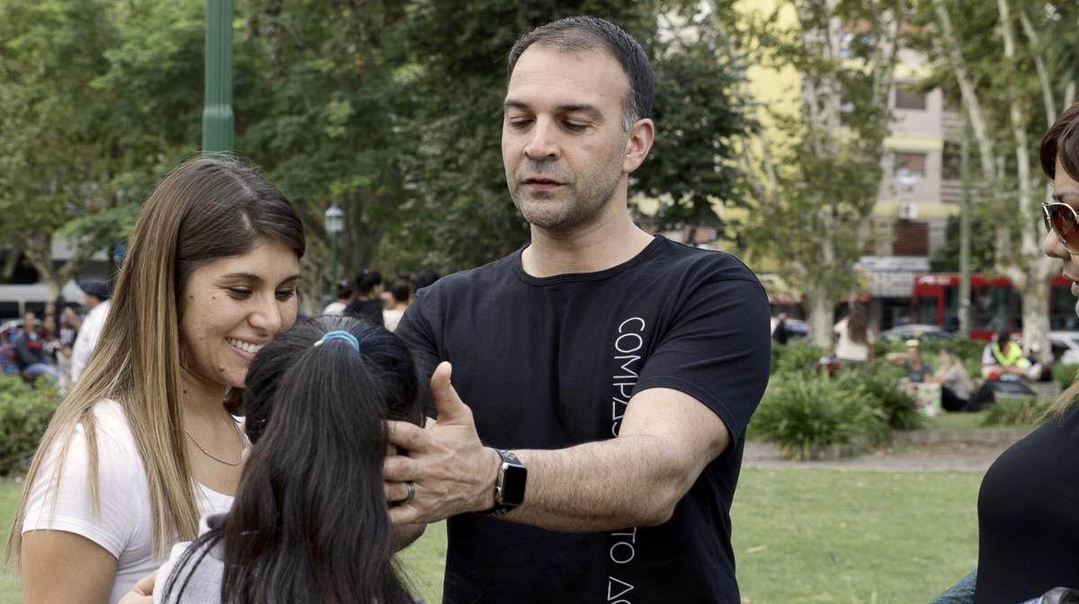 Commission To Action team member, Shane Lorente, is seen here praying for a young deaf girl. The girl began to cry and after putting in earbuds, could hear the music, and was healed of deafness. Photo by Jacob Granneman, Courtesy of Compassion To Action
