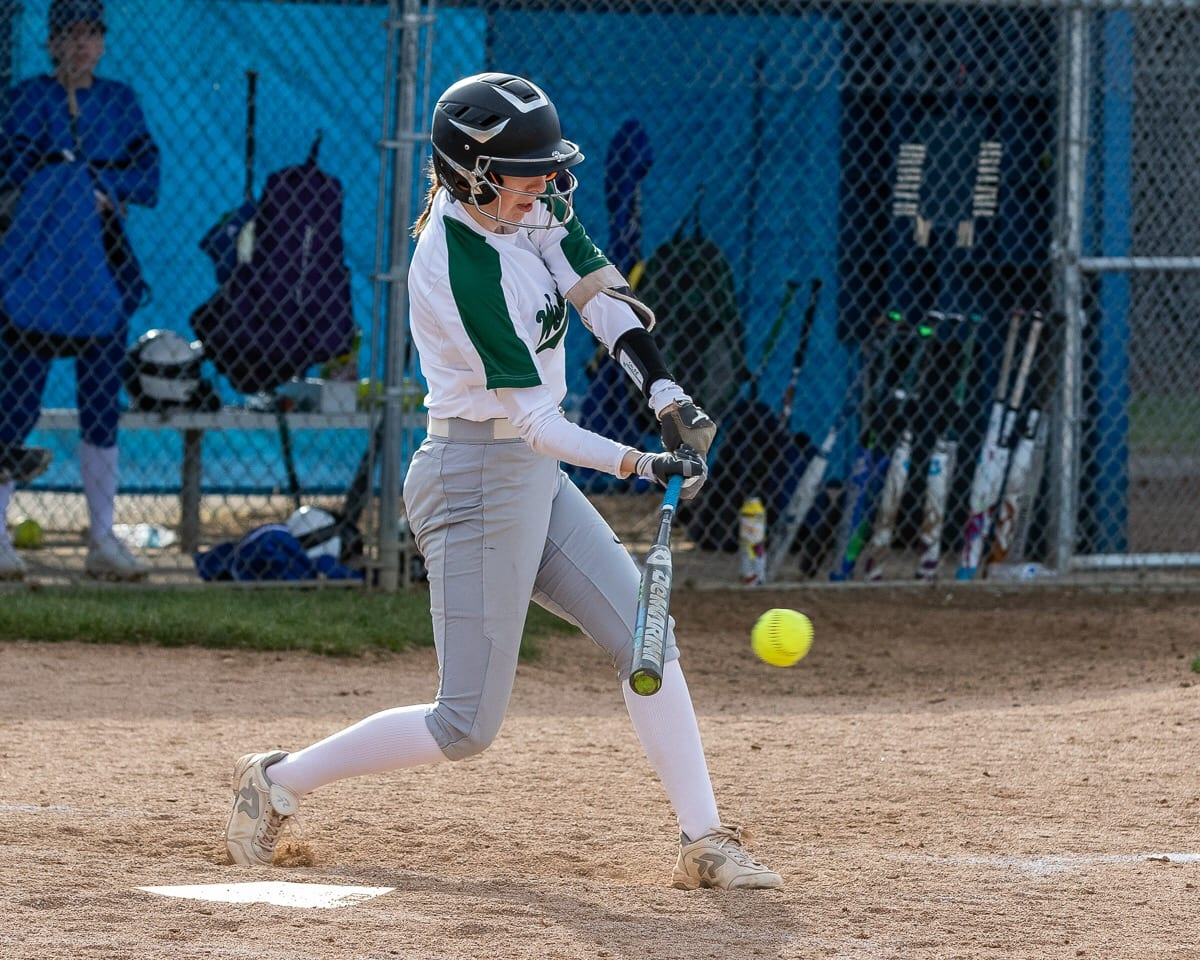 Chloe Eddy keeps her eye on the ball as she takes a swing during a recent game. Woodland's offense is back strong this season. Photo by Mike Schultz