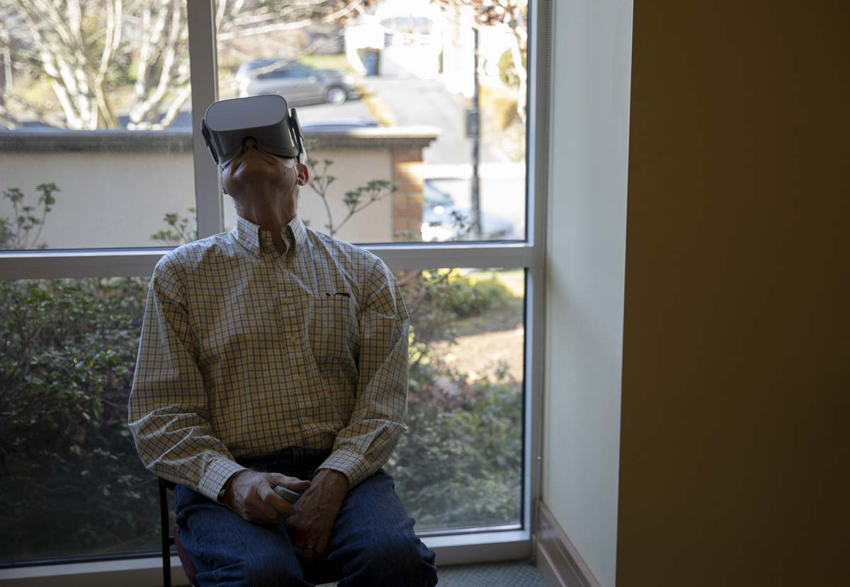 Cliff Anderson is seen here watching the Apollo 11 launch and moon landing through a virtual reality headset at the Camas Public Library. Photo by Jacob Granneman