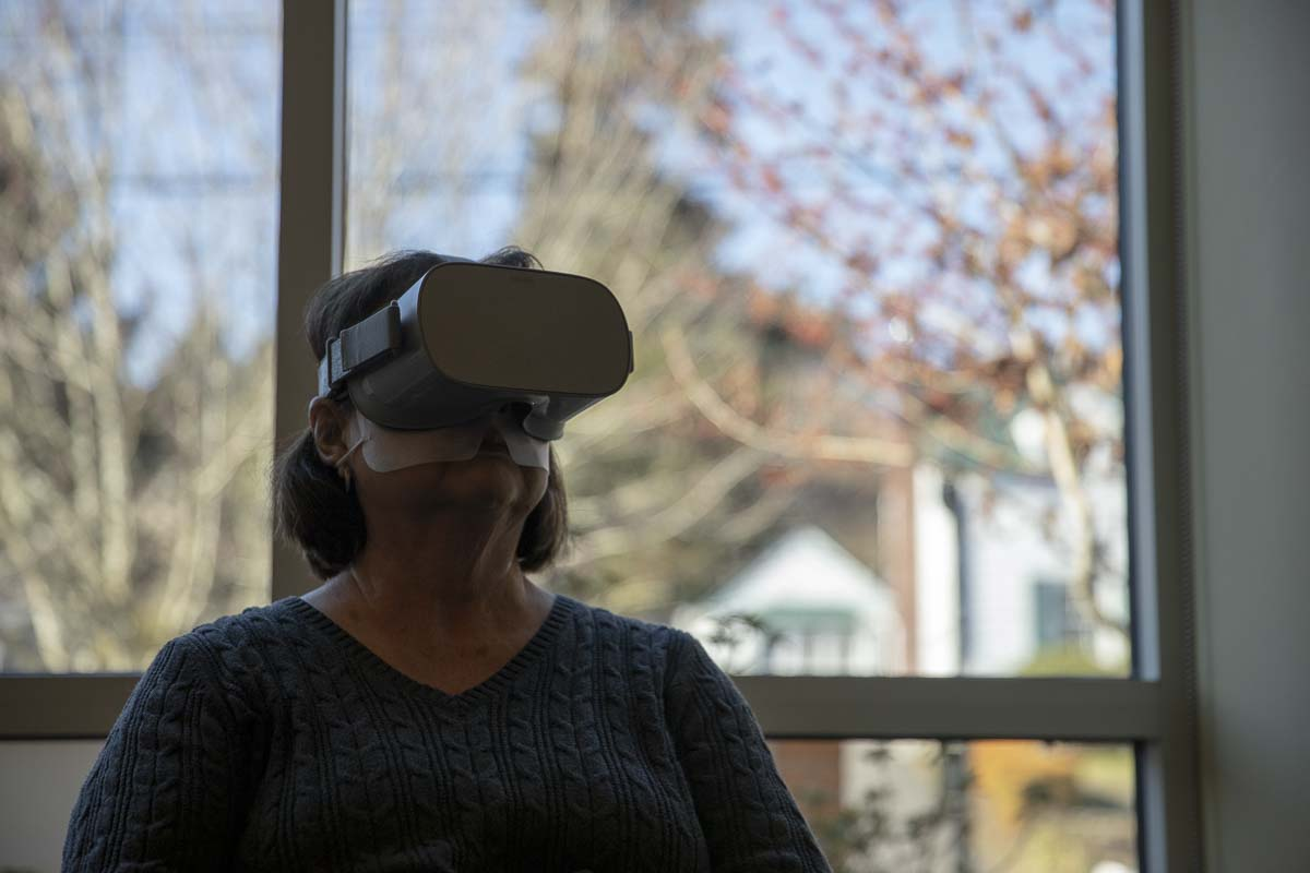 Sandy Anderson uses the Oculus Go, portable virtual reality headset, at the Camas Public Library. The VR headsets are part of a grant from the Washington State Library on VR and education. Photo by Jacob Granneman