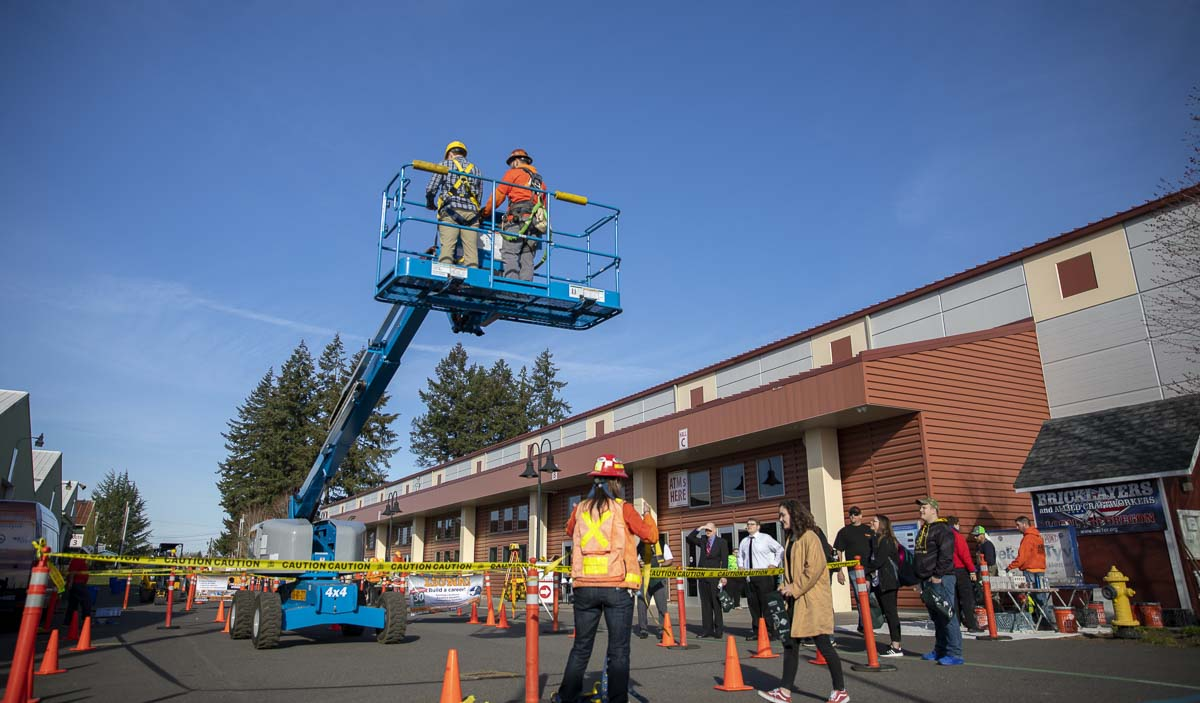 Apprenticeship programs, like those in LiUNA, operate several demonstrations of heavy construction equipment for students touring the 2019 Youth Employment Summit outside the Clark County Event Center. Photo by Jacob Granneman