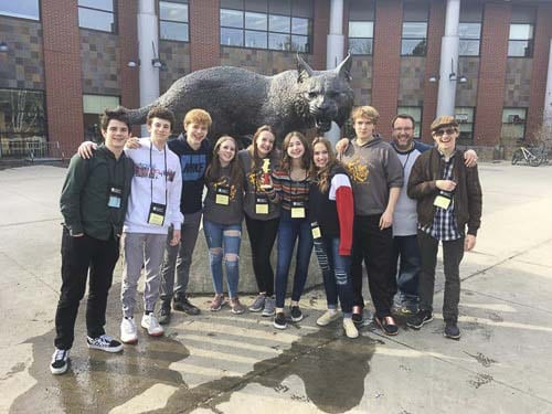"Hockinson High School Theater's cast of ""Rumors"" stands outfront of Central Washington University's Student Union Building at the 2019 Washington State Thespian Festival. Photo courtesy of Hockinson High School Theater Co."