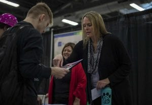 Jennifer Bishop, of PeaceHealth, explains career opportunities with a students during the summit. PeaceHealth employs some 16,000 caregivers, and has many entryways that do not require college. Photo by Jacob Granneman