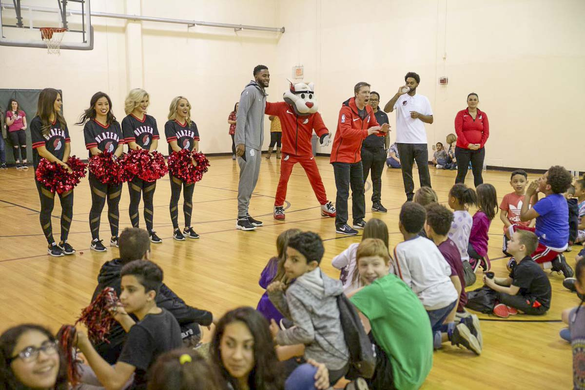 Portland Trail Blazers forward Maurice Harkless (gray sweat suit) and other members of Portland's National Basketball Association organization surprised over 70 area children last week with a takeover of their youth basketball clinic in Vancouver. Photo courtesy of Randy L. Rasmussen/Rose Quarter