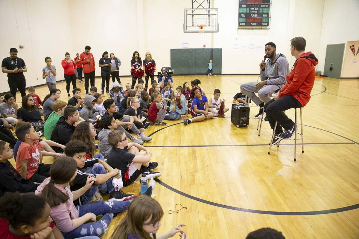 Maurice Harkless (with microphone) addresses a group of area children at a free clinic Friday at the Boys & Girls Club of Southwest Washington in Vancouver. Photo courtesy of Randy L. Rasmussen/Rose Quarter