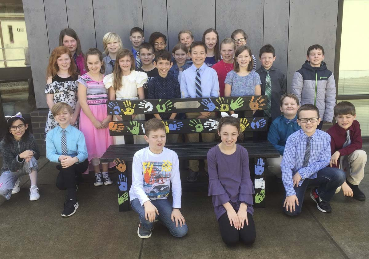 Fourth graders from Karen Moses' class at South Ridge Elementary School in Ridgefield stand with the new Friendship Bench donated to the school. Photo courtesy of Ridgefield School District