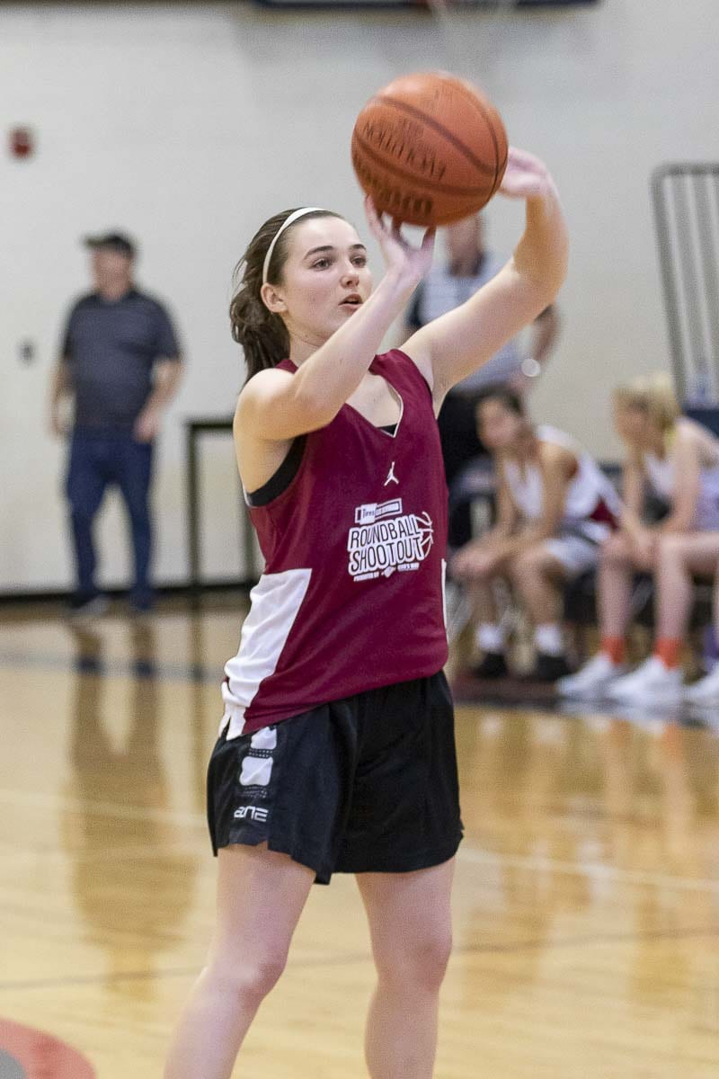 Hannah Booth of Camas won the 3-point contest, then made four 3-pointers during the all-star game, helping her team to victory at the Les Schwab Tires Roundball Shootout. Photo by Mike Schultz