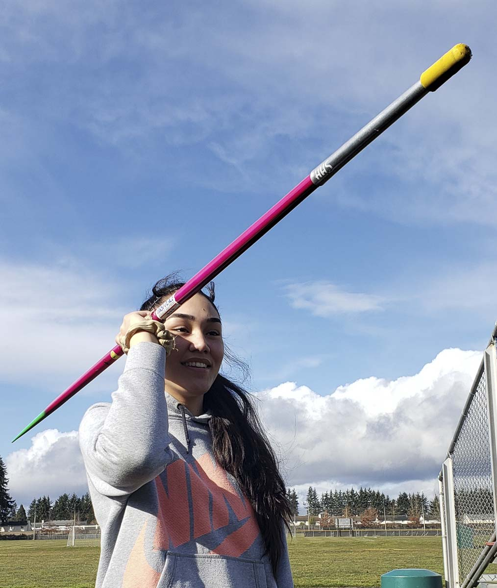 Katie Peneueta has a new drive. Unsure of what sport she was going to compete in this spring for Heritage, a message for a two-time Olympian from Clark County inspired Peneueta to give the javelin one more try. Now, she wants to break the school record and see just how far the javelin can take her. Photo by Paul Valencia.