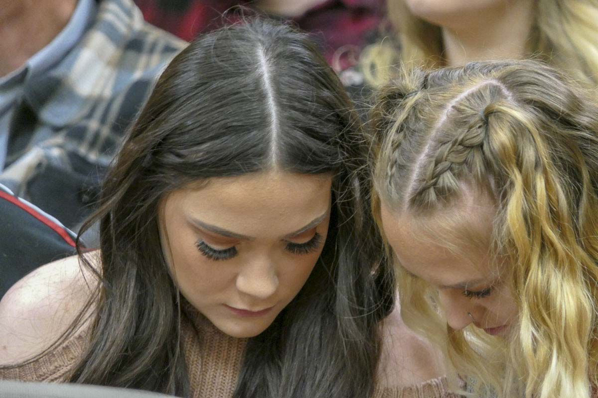 Jordan Holgerson, left, sits with her friend Ryan Anderson during sentencing for the woman who pushed her from the Moulton Falls Bridge last August. Photo by Chris Brown