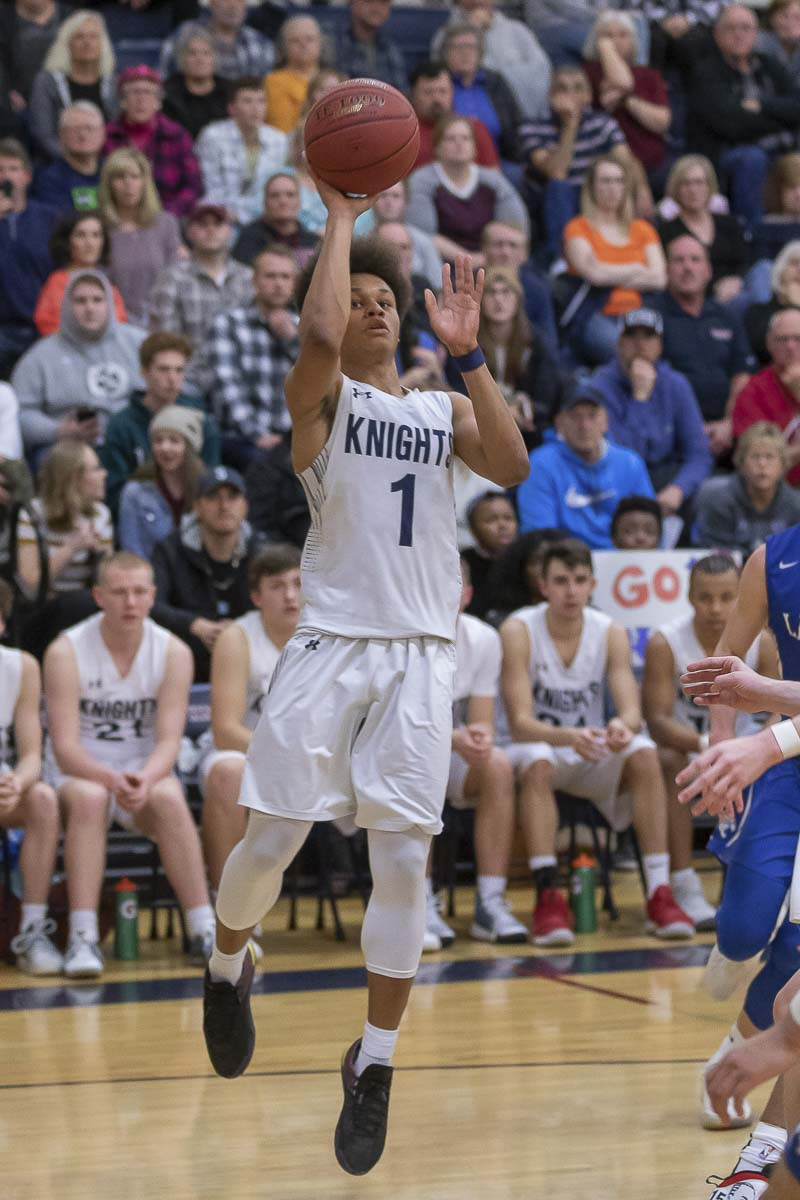 King's Way Christian's Khalfani Cason (1), shown here in a game earlier this season, hit the game-winning shot Friday to send the Knights into Saturday's Class 1A boys state championship game at the Yakima Valley SunDome. Photo by Mike Schultz