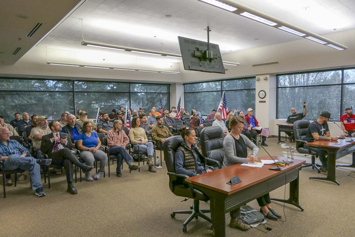 Members of Patriot Prayer at Battle Ground city council chambers to hear an appeal of their permit to use Kiwanis Park this weekend. Photo by Chris Brown