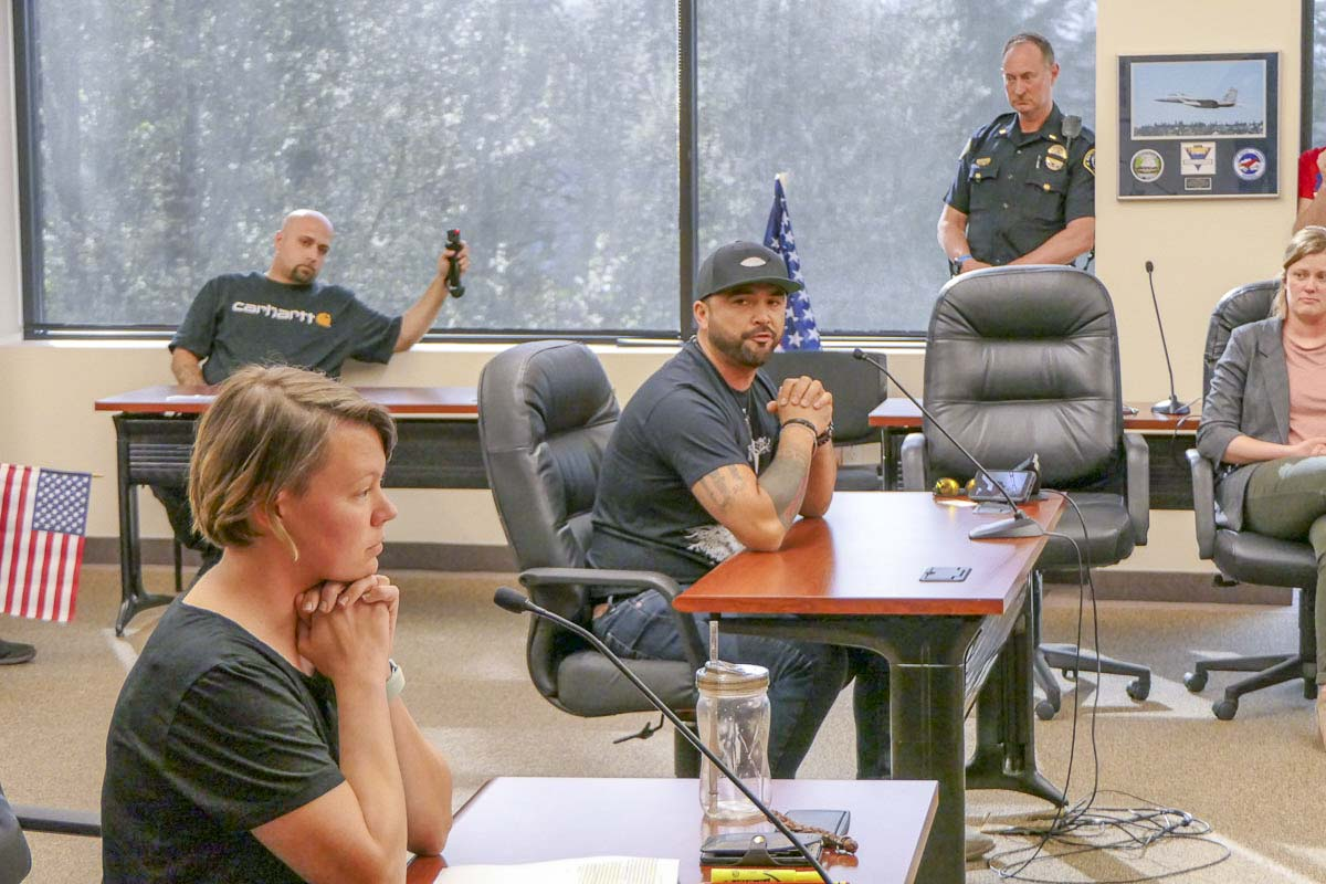 Meagan Wadleigh of United BG looks on as Patriot Prayer leader Joey Gibson responds to her group's appeal of a permit to use Kiwanis Park for an event this weekend. Photo by Chris Brown