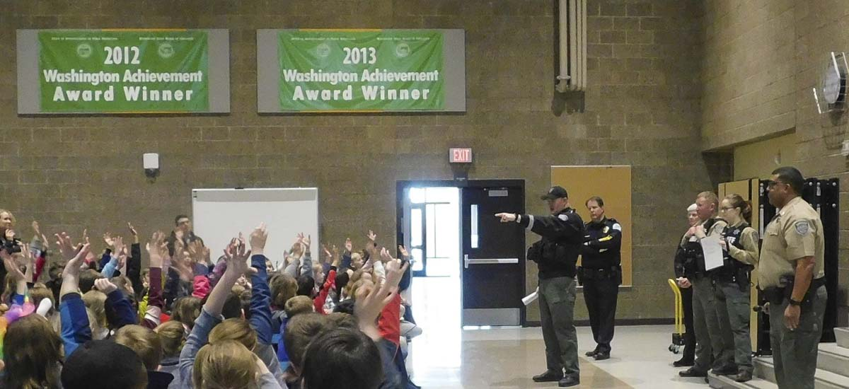 South Ridge Elementary School students ask questions about school safety during a visit by the Police Activities League from the Clark County Sheriff's Office. Photo courtesy of Ridgefield School District