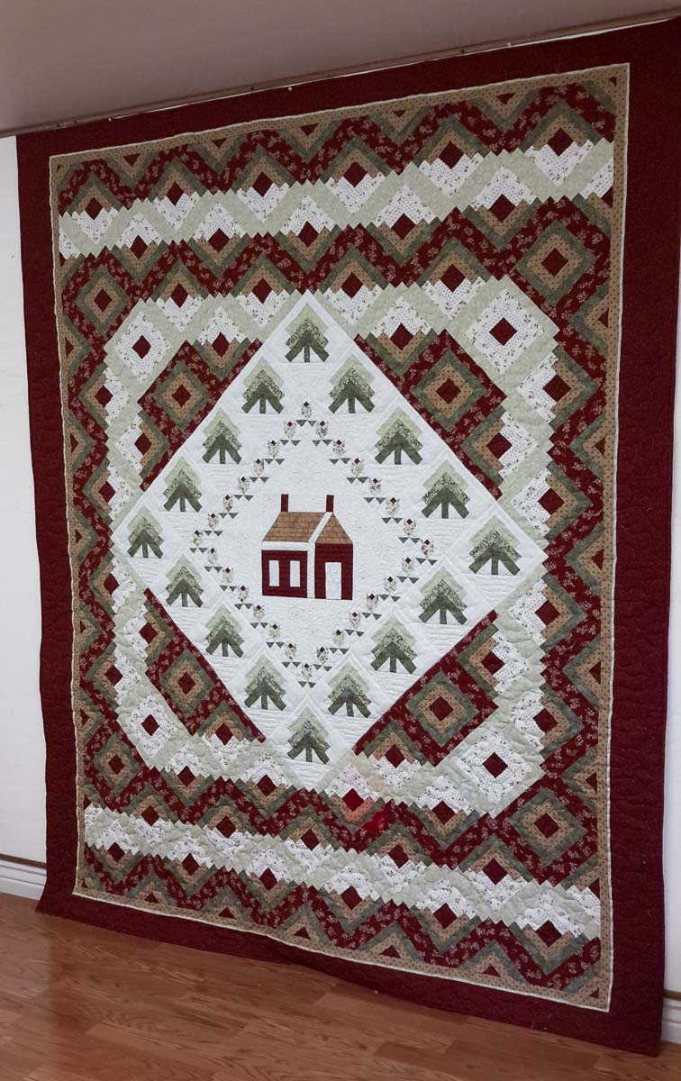 "The North Clark Historical Museum 2019 Raffle quilt is shown here. The quilt is entitled ""Cabin in the Woods.'' Photo courtesy of North Clark Historical Museum"