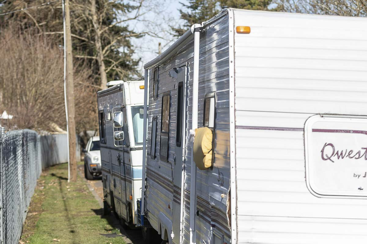 Neighbors along NE 13th Avenue in Hazel Dell say they pick up buckets full of trash from homeless people living in derelict RVs along the road. Photo by Mike Schultz