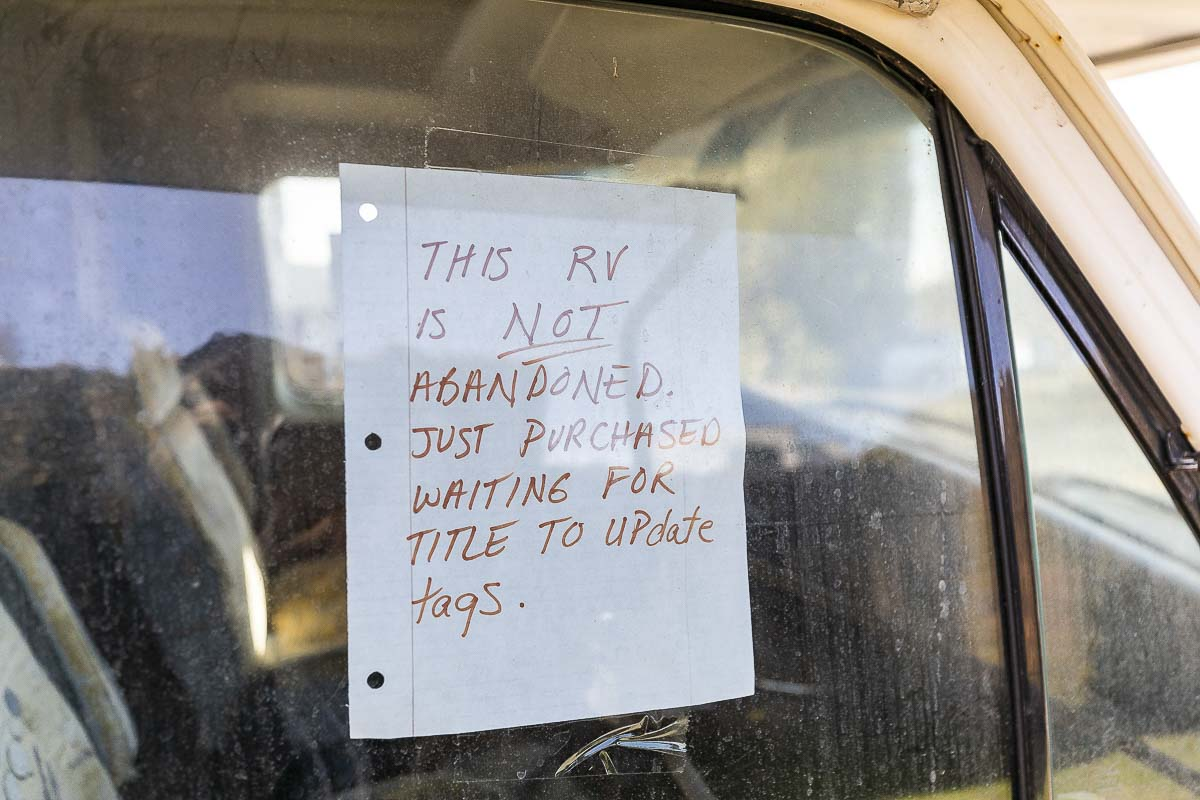 A sign hangs in a window of an RV parked along NE 13th Avenue in Hazel Dell. Photo by Mike Schultz
